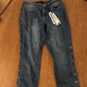 High waist skinny jeans with grommets detailing